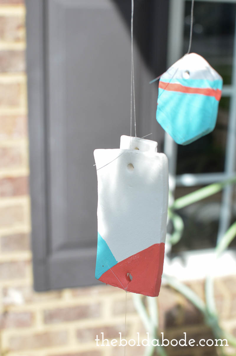 How to Make DIY Clay Chimes from air drying clay.  These make such a fun, colorful addition to the porch!