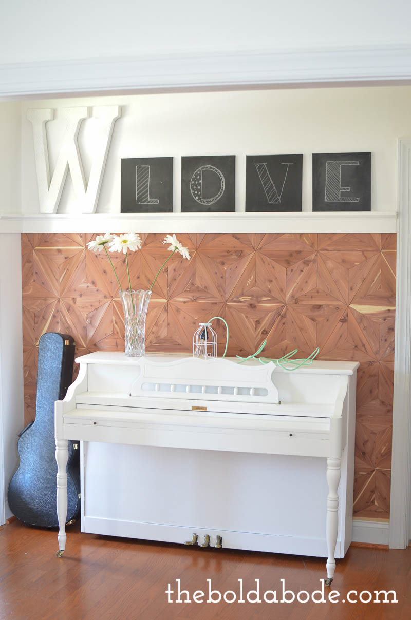 Create one of a kind Cedar Planked Wall with this diy tutorial. Instead of planks, cut triangles and you'll have a beautiful statement wall like no one else!