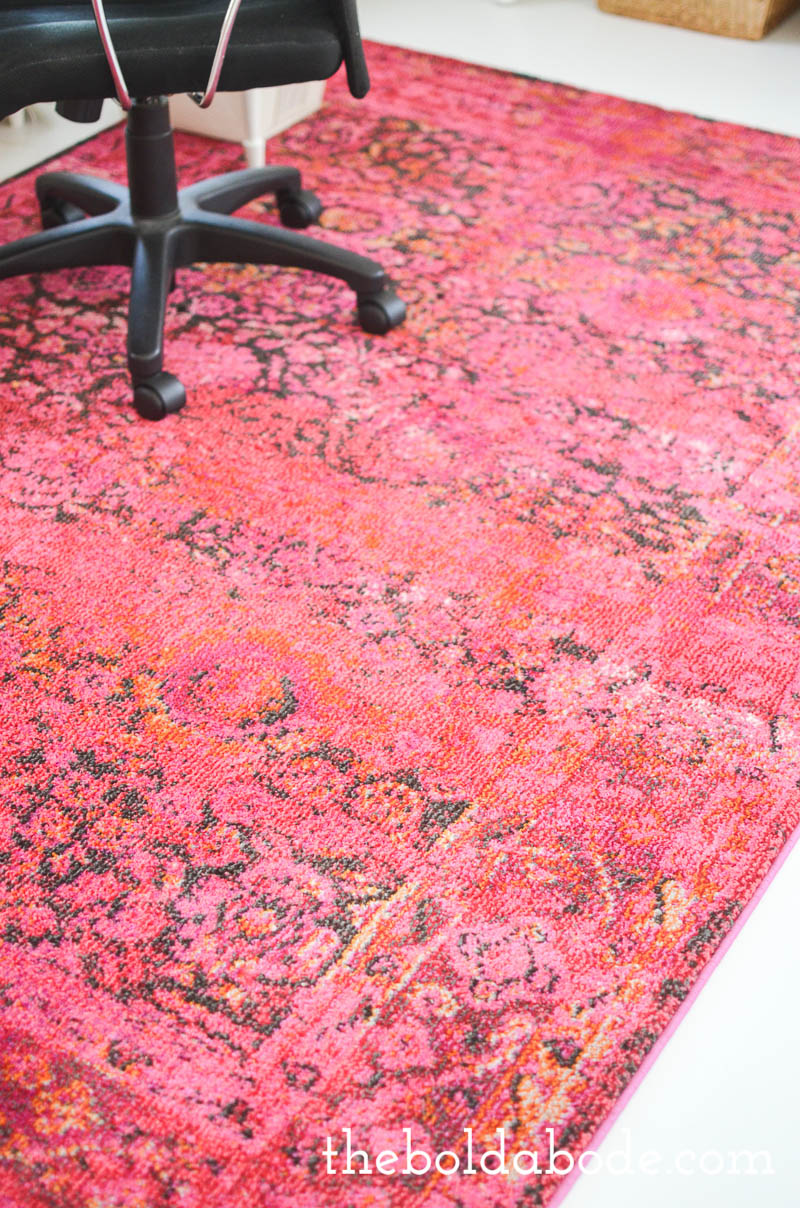 White Floors with a gorgeous Pink Rug