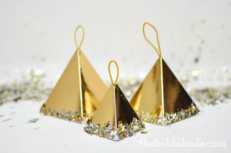 Make these gorgeous Gold Confetti Pyramid Ornaments in no time at all. It's hard to believe these are just made out of paper!