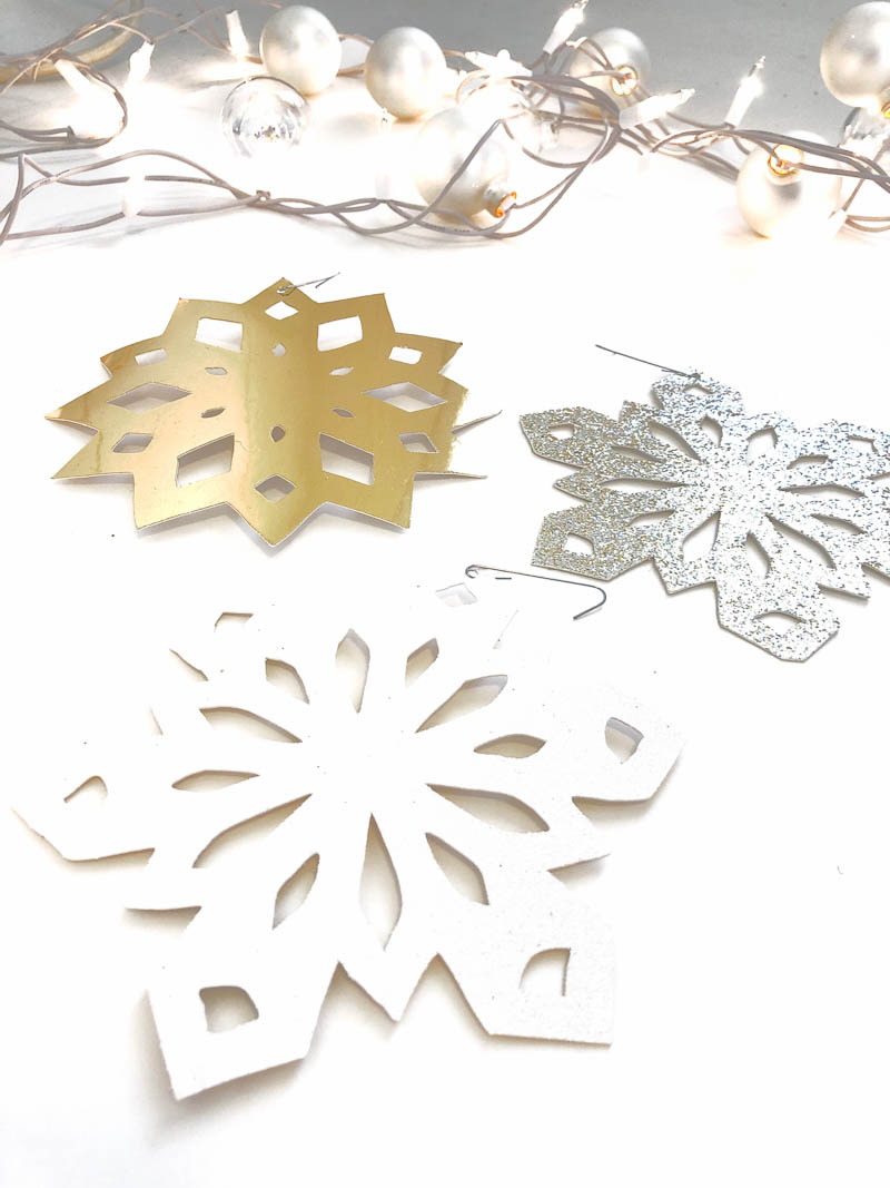 DIY gold foil snowflake ornaments)