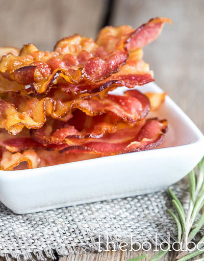 crispy bacon in a bowl with some rosemary