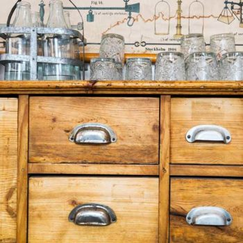 vintage sideboard with glassware