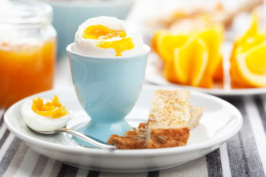 soft boiled egg with toast and orange