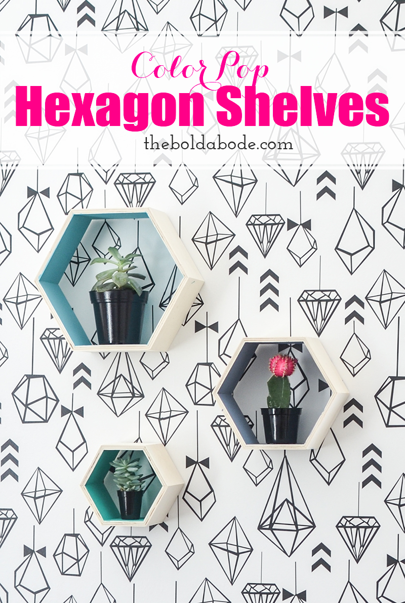 3 hexagon shelves on a wall covered in modern geometric ornaments wallpaper