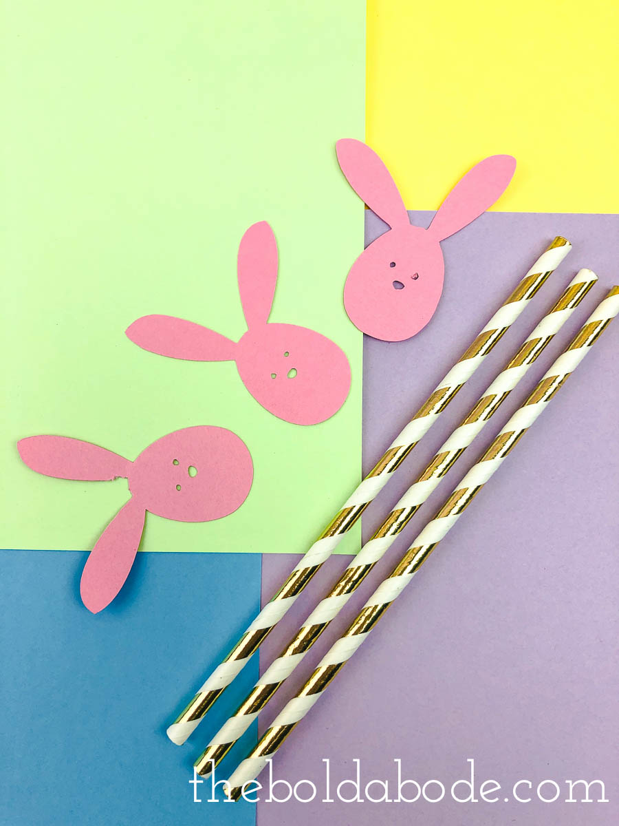 gold and white straws with bunny face cutouts