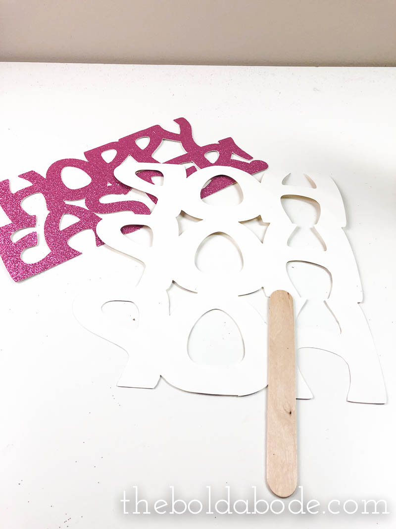 glueing craft stick onto easter photo props