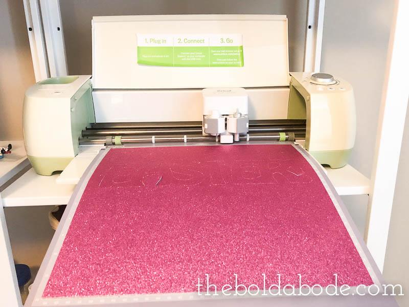 cricut machine cutting out glitter card stock