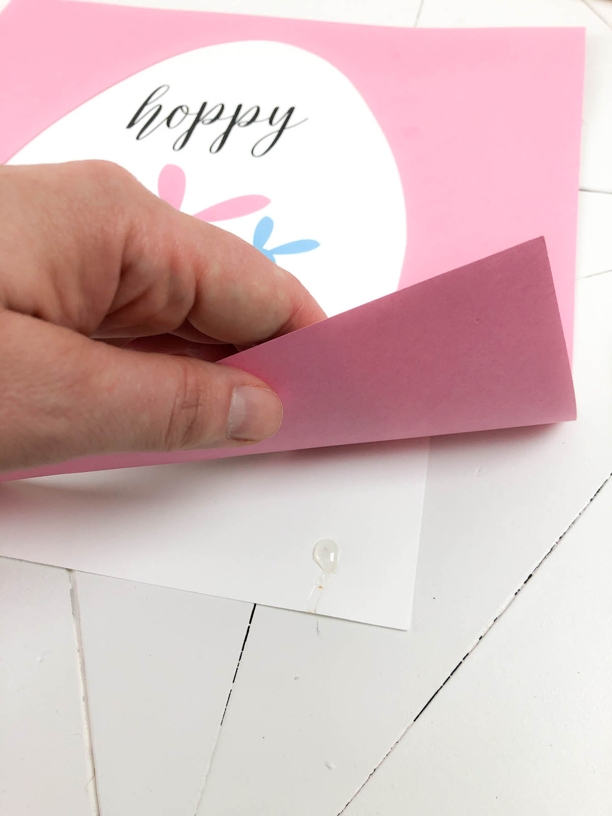 gluing the printable to the pastel scrapbooking paper