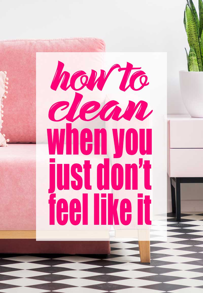 "pink couch with black and white floor, graphic text overlay which says, ""how to clean when you just don't feel like it"""