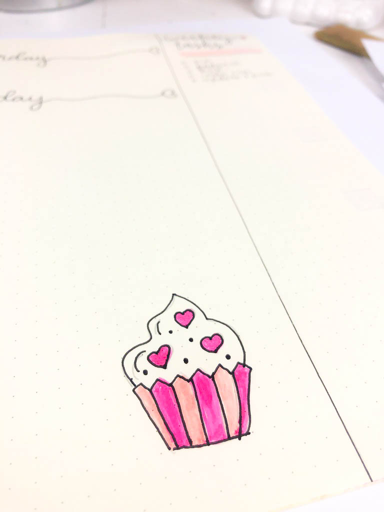 picture of a notebook with a doodle of a cupcake with hearts and polka dots on it