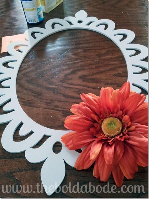 Glueing daisy on wreath